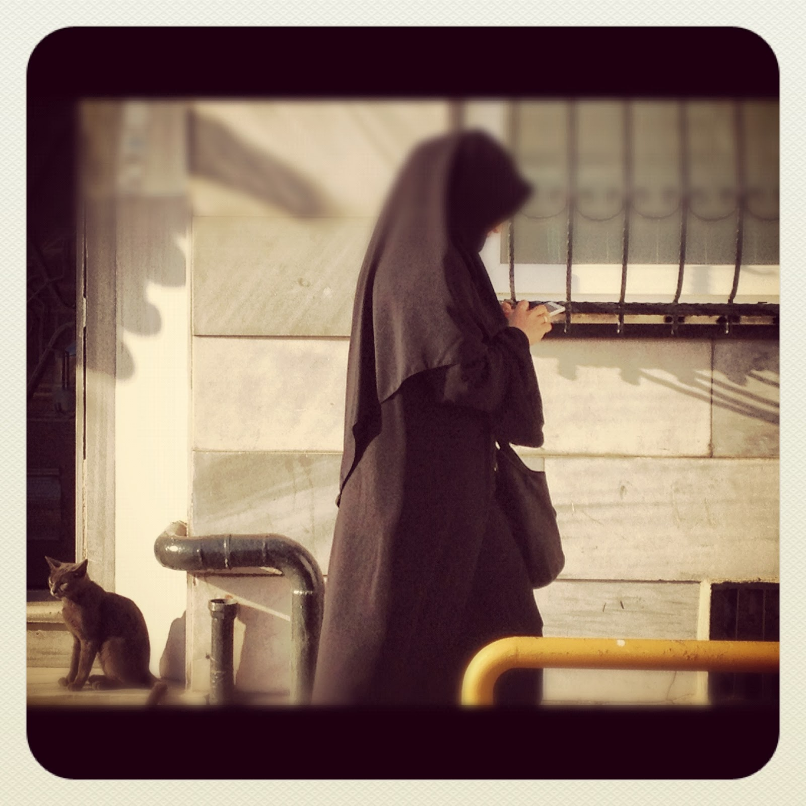 Muslim Woman Texting in Istanbul